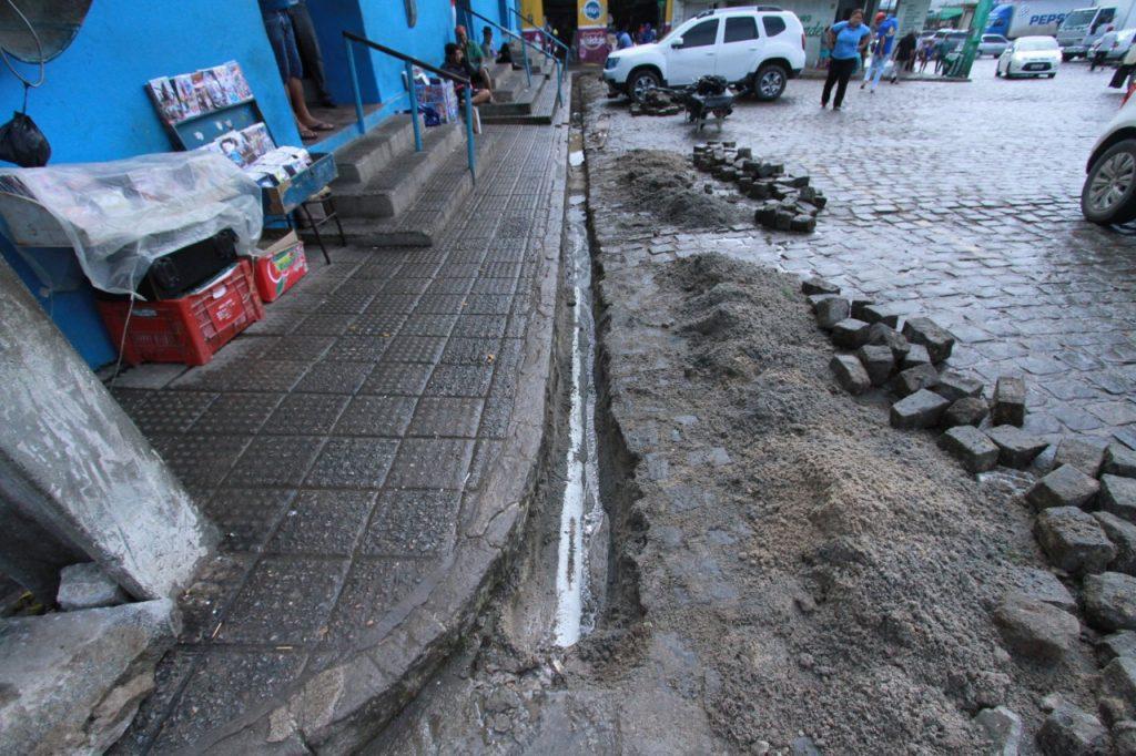 - A car parked on a sidewalk - Geology